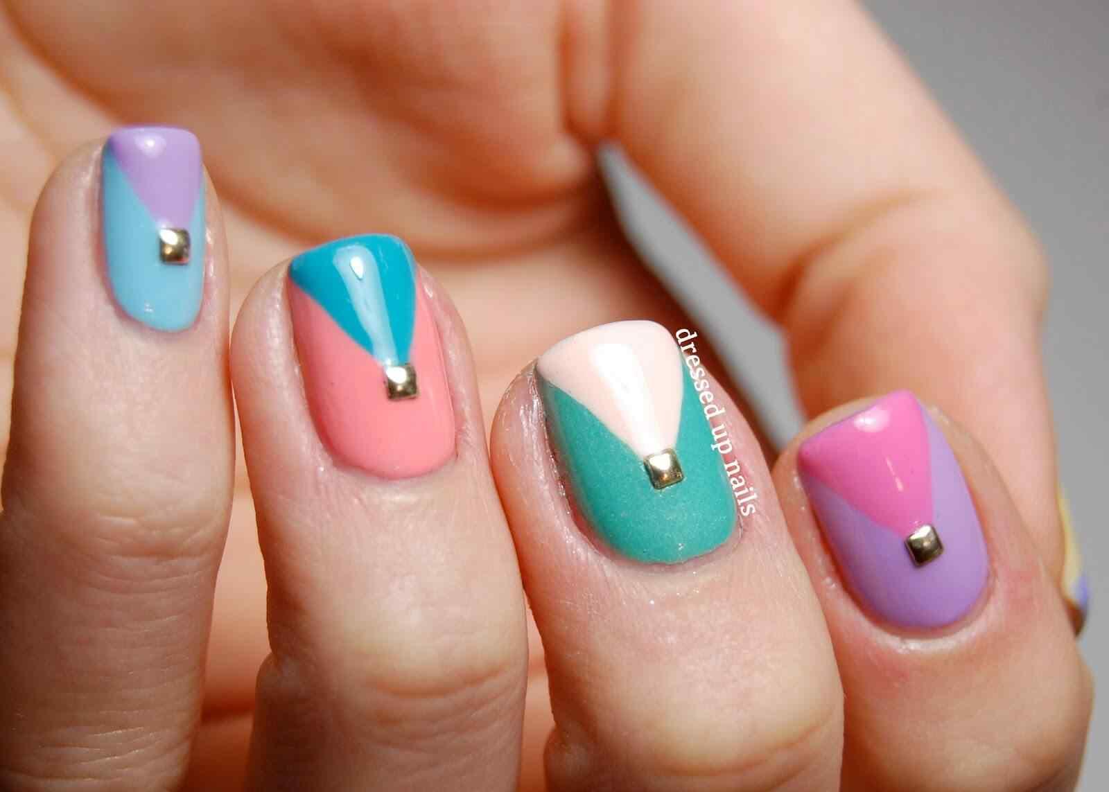 http://www.smackerlacquer.com/pastel-negative-space-nail-art/