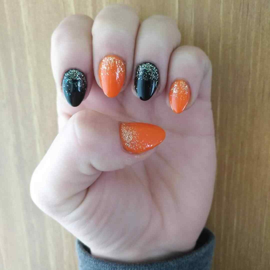 orange nails with glitter and black