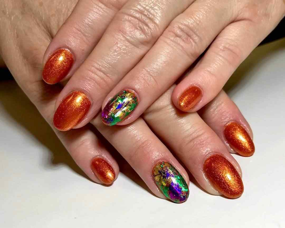 orange with green and purple golden nails