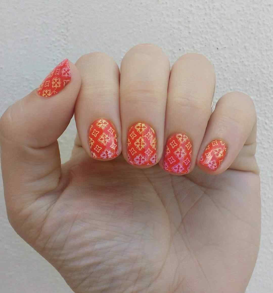 uñas naranja estampadas