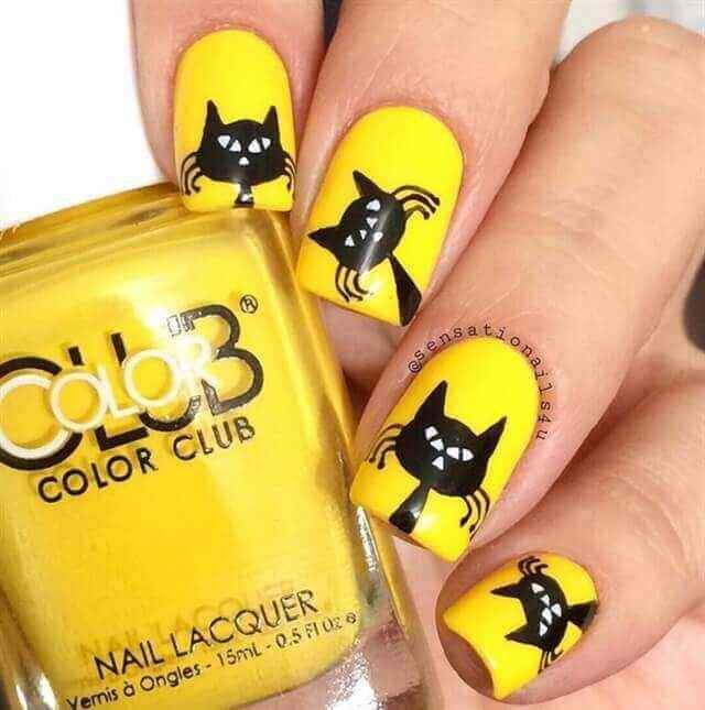 uñas amarillas con gato negro