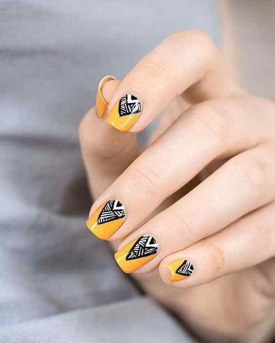 uñas amarillas con negro y blanco