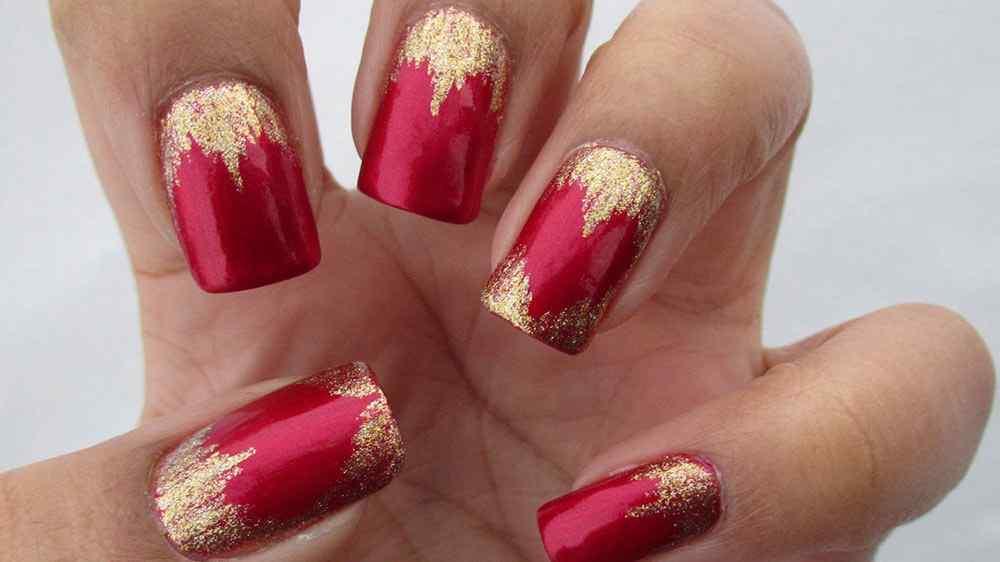 uñas san valentin rojo y dorado