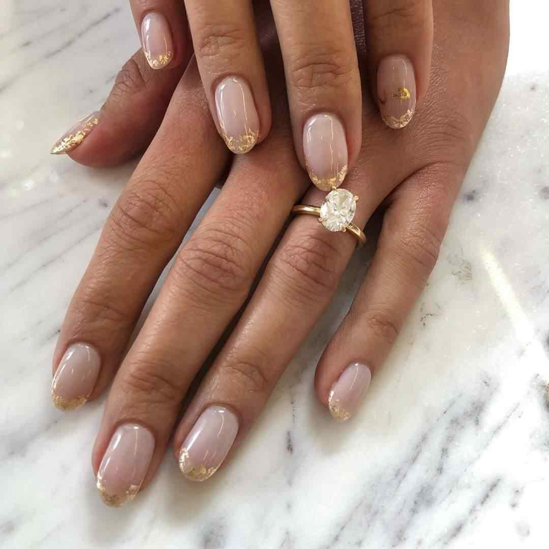 uñas francesas doradas para novia