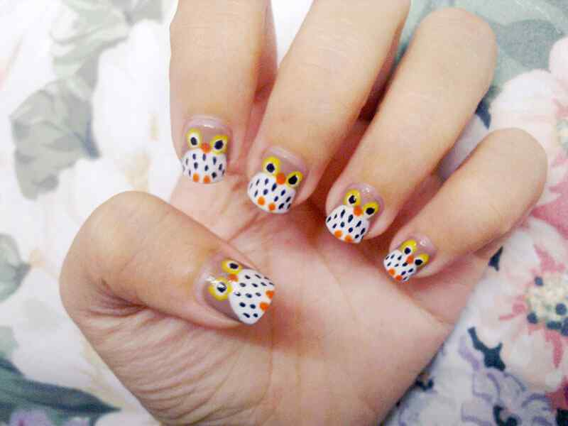 diseño de uñas con buhos