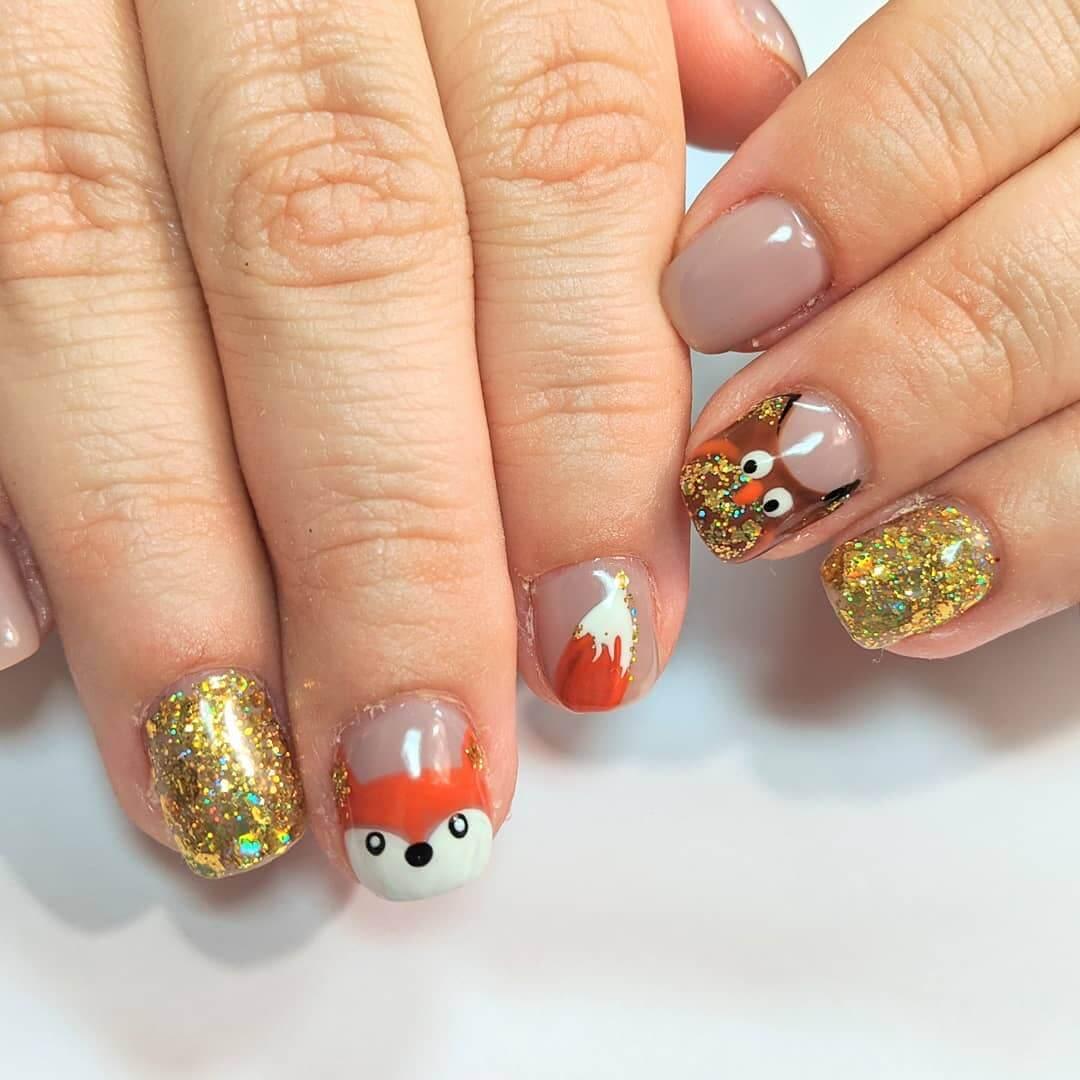 decorado de uñas con buhos