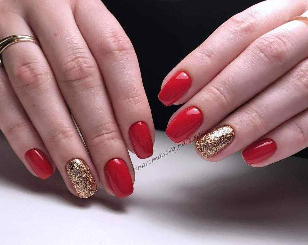uñas invierno rojas y dorado