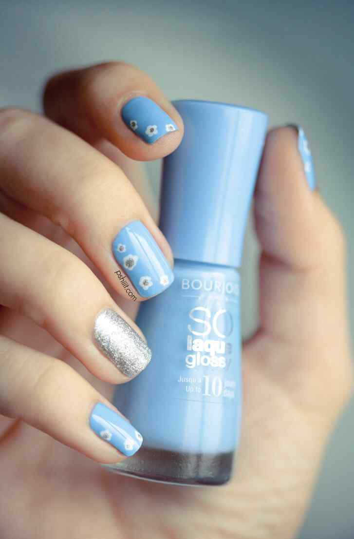 Celestial and silver nail decoration