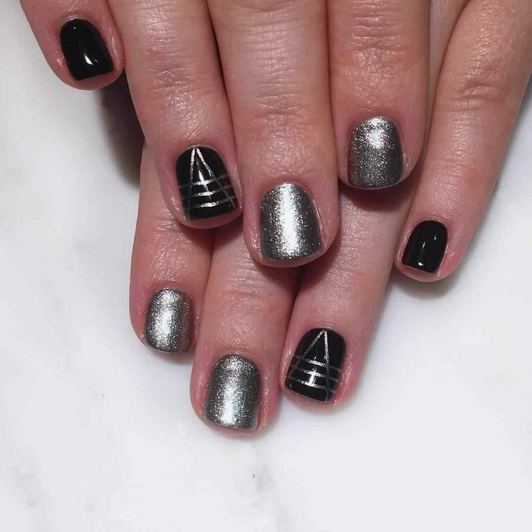 uñas plateadas y negro