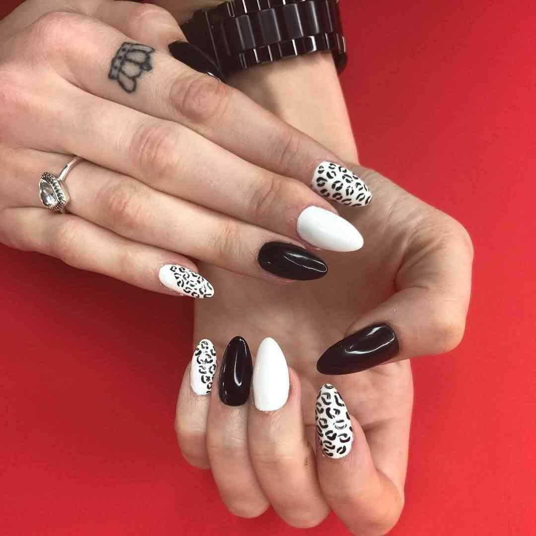 uñas blancas y negras animal print