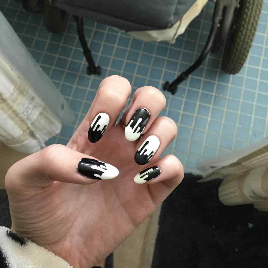 uñas blancas y negras