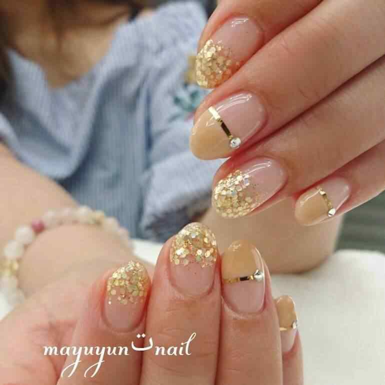 decoracion de uñas doradas elegantes