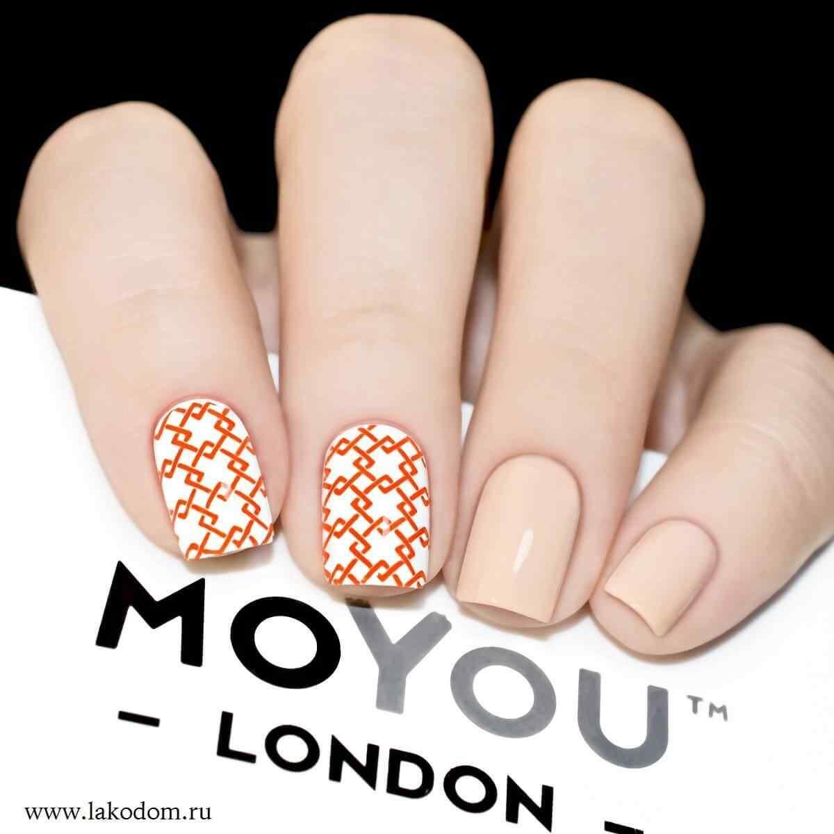 diseño de uñas geométricas naranja