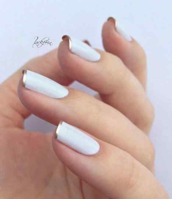 uñas francesas blanca y dorado