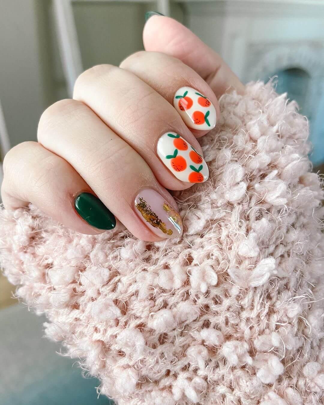 uñas decoradas con naranjas para el verano