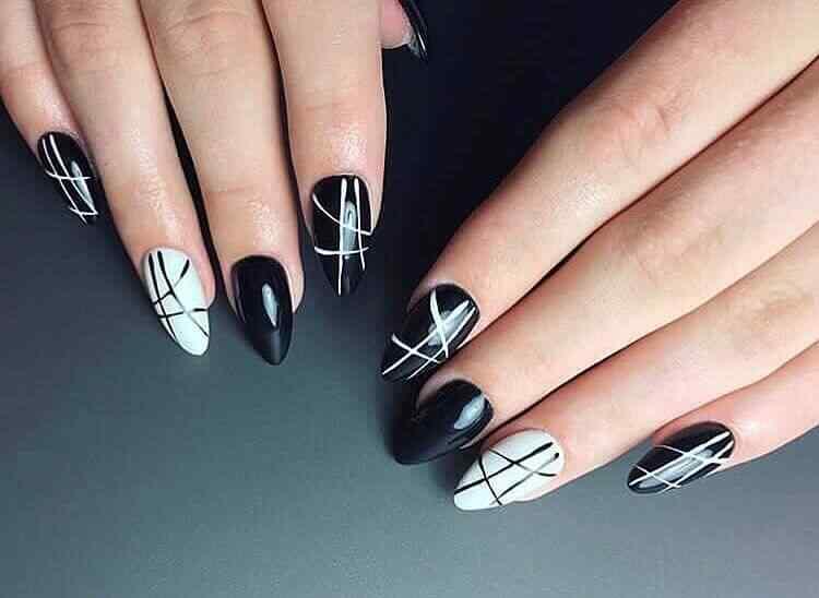 uñas negras con blanco