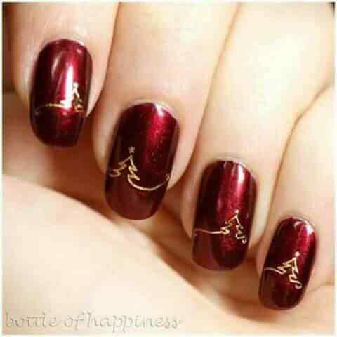 uñas de navidad rojas con dorado
