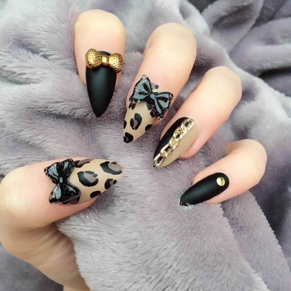 uñas stiletto anima print leopardo
