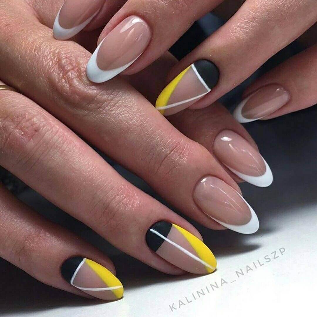 diseño de uñas amarillas con blanco y negro