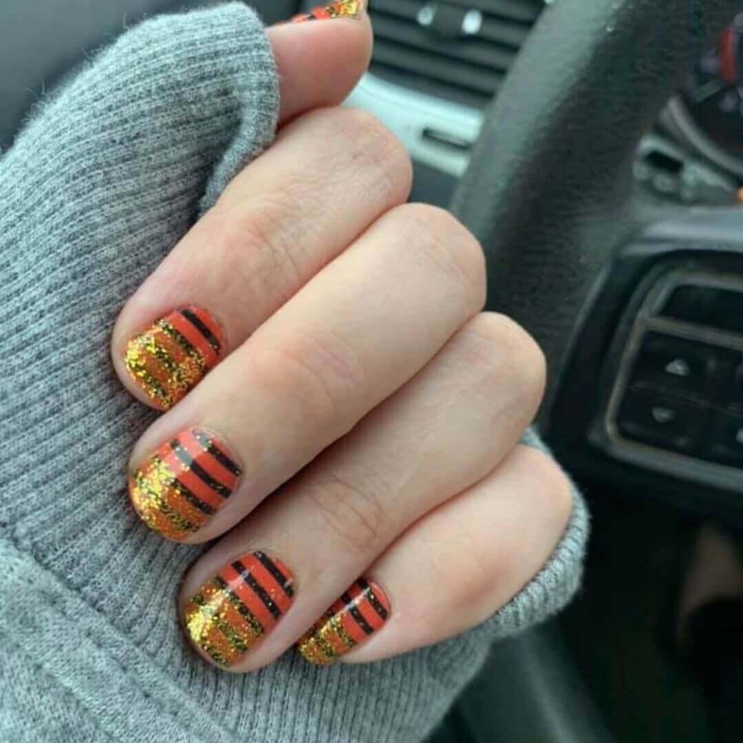 diseño de uñas color naranja