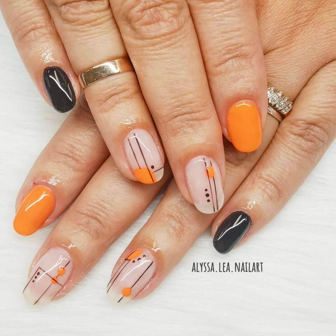 diseño simpl de uñas color naranja