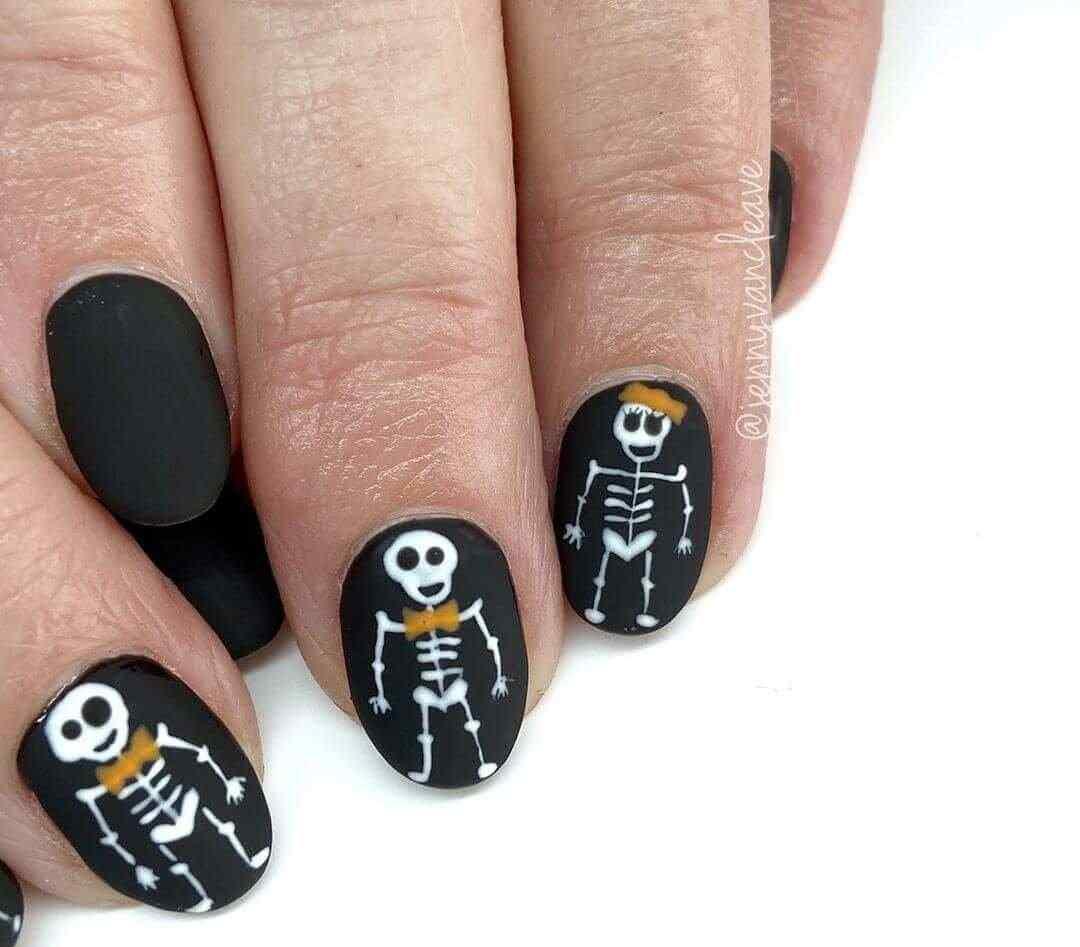 diseño de uñas esqueleto halloween