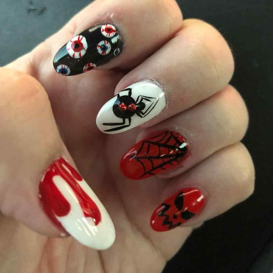 modelos de uñas con arañas para halloween