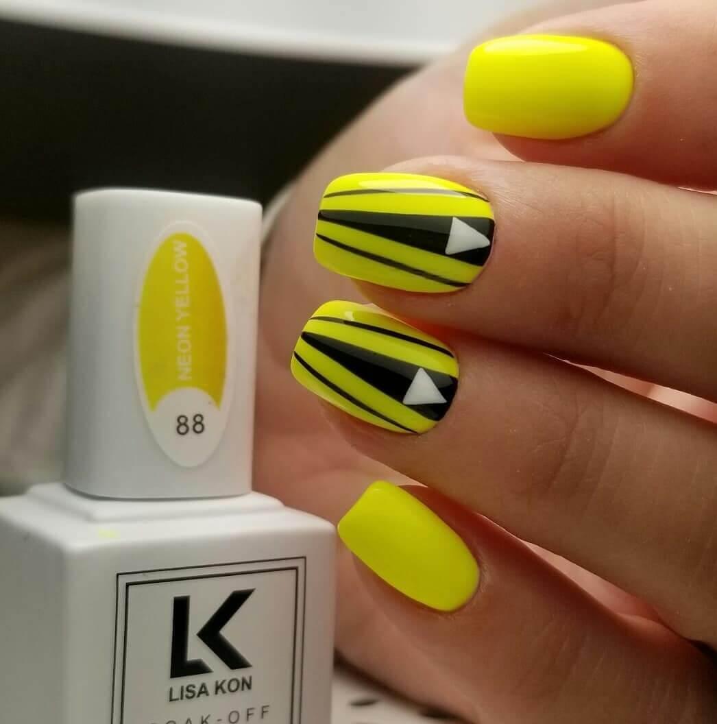 uñas amarillas con negro