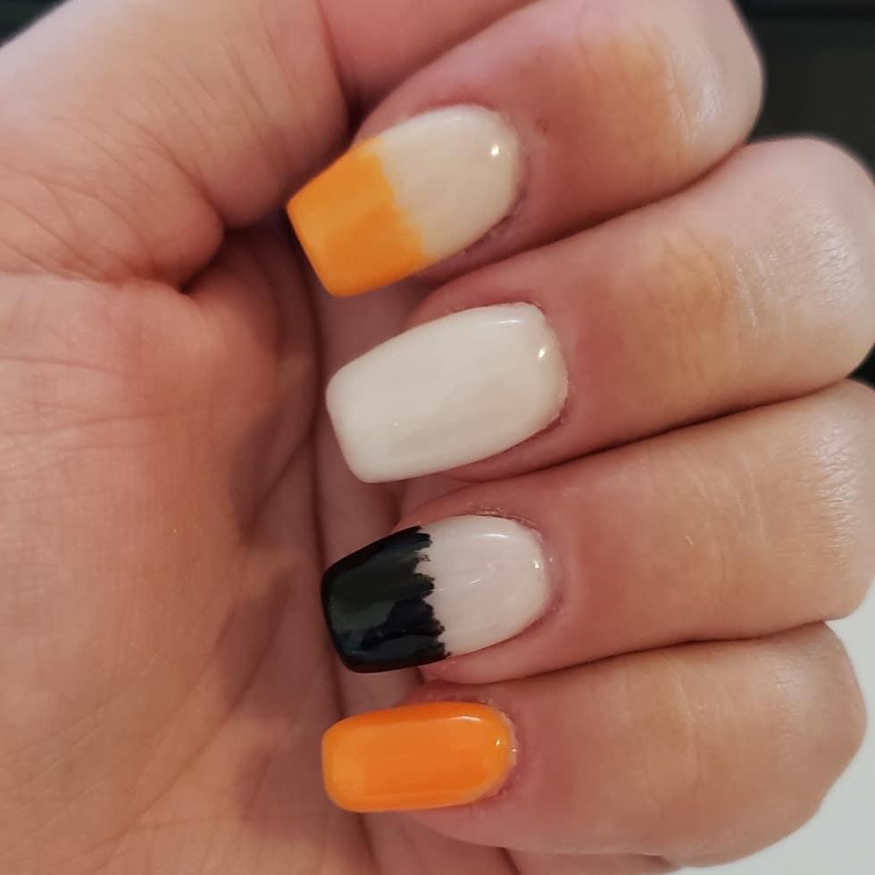 uñas blancas con naranja