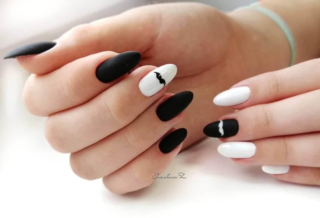 uñas blancas y negras con mustache