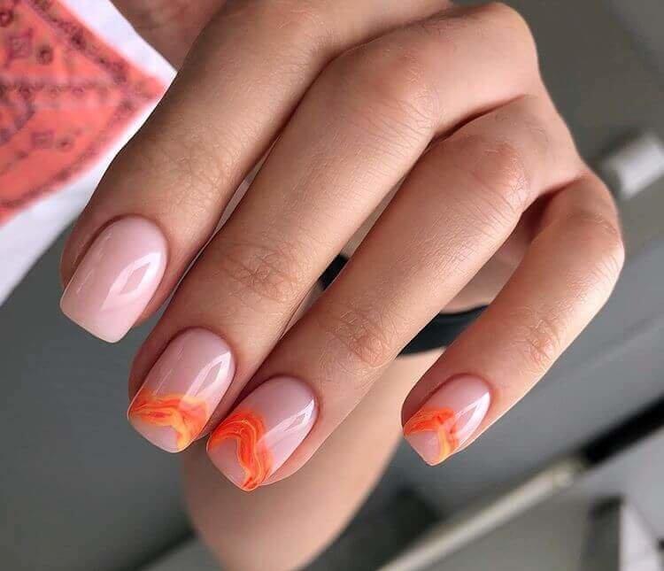 uñas color naranja con diseños