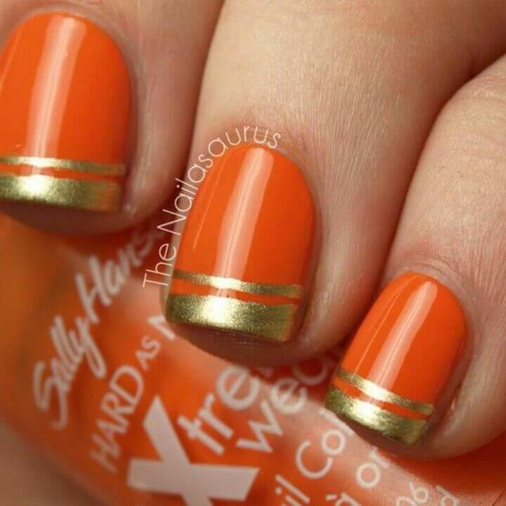 uñas color naranja con francesa dorada