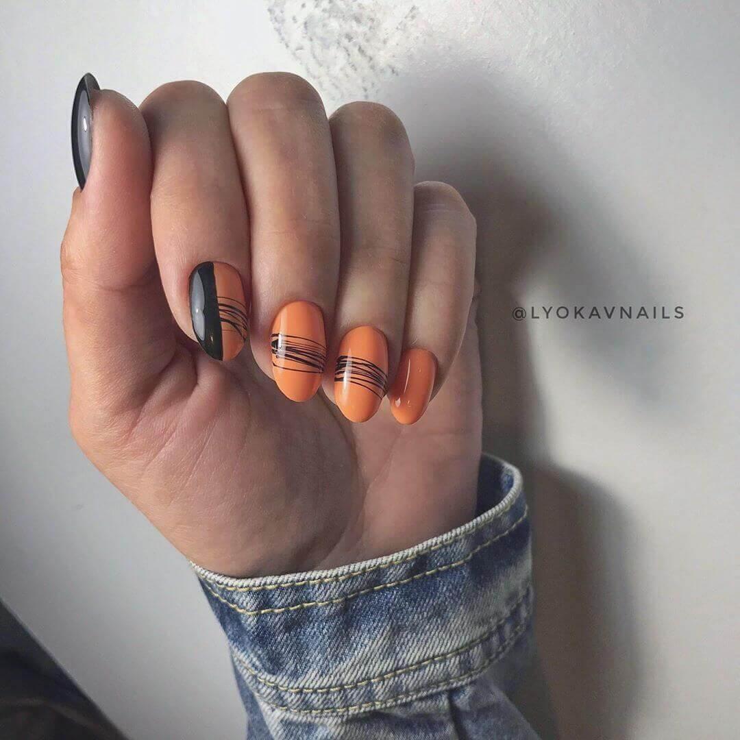 uñas color naranja con negro