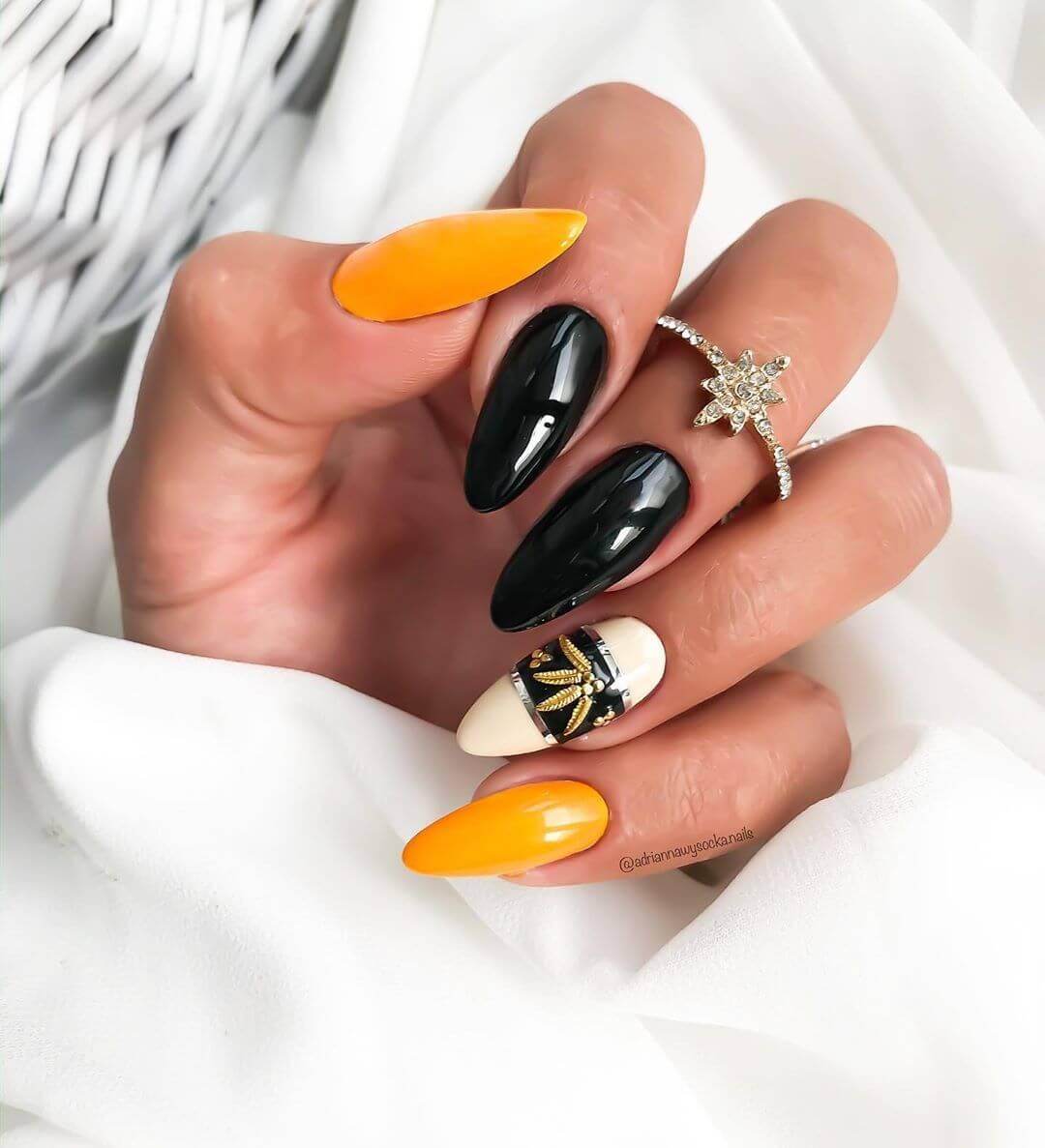 uñas decoradas amarillo mostaza con negro