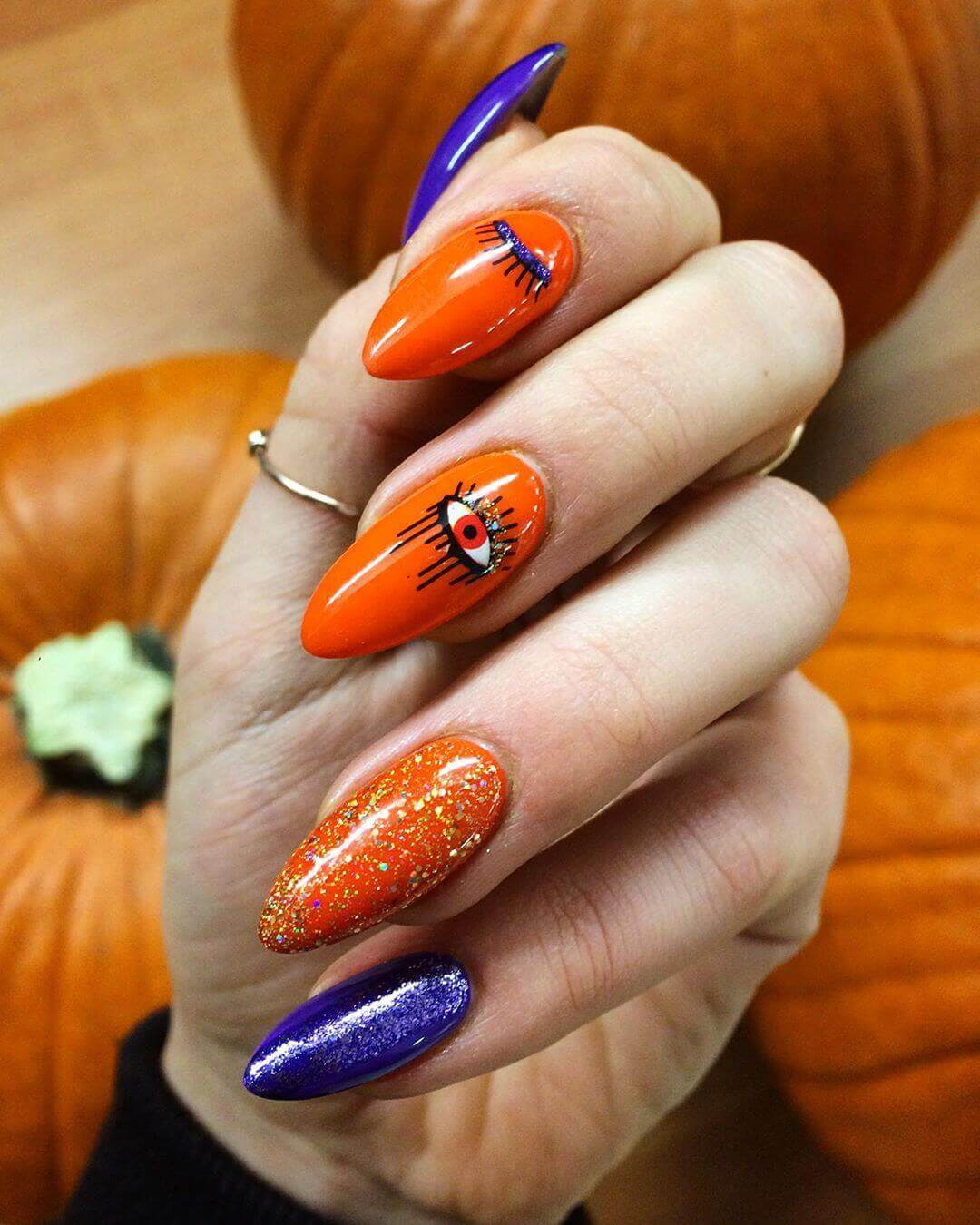 Nails decorated orange with blue