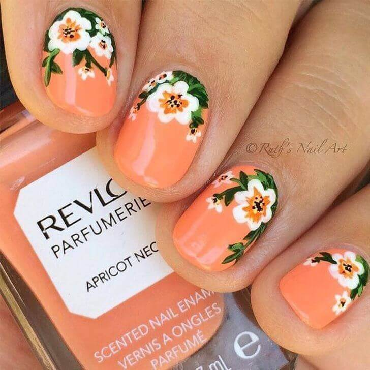 orange decorated nails and flowers