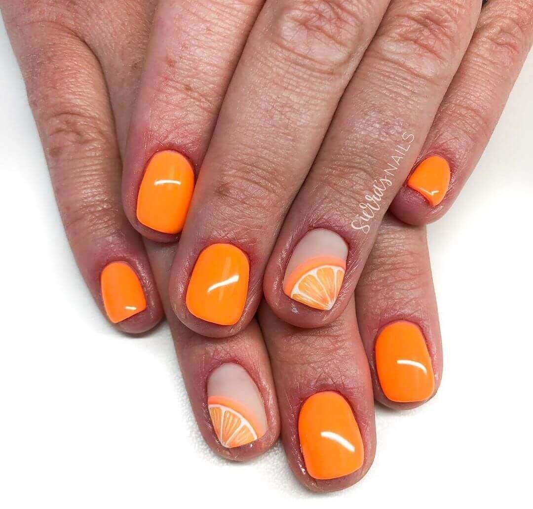 uñas decoradas con naranja