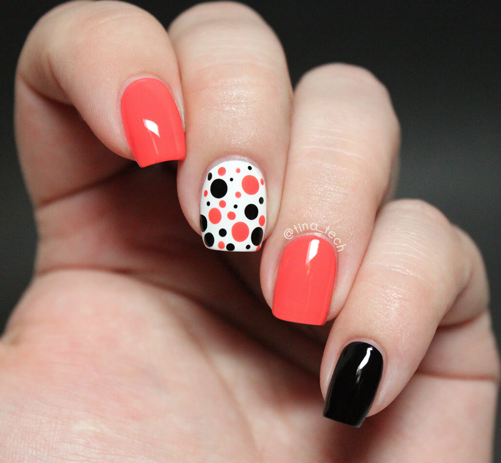 orange decorated nails with black dots