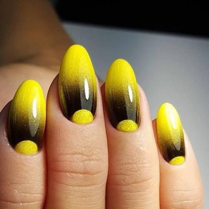 uñas degradadas de amarillo a negro