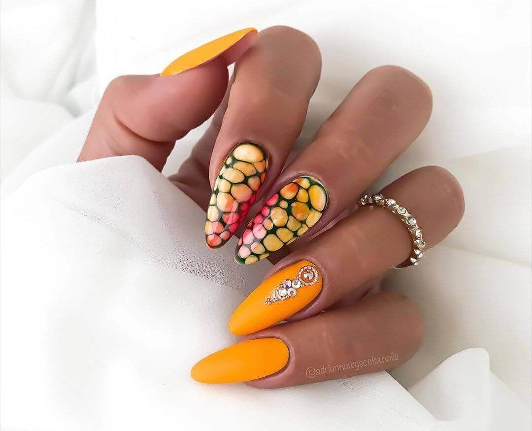 elegant nails decorated in orange