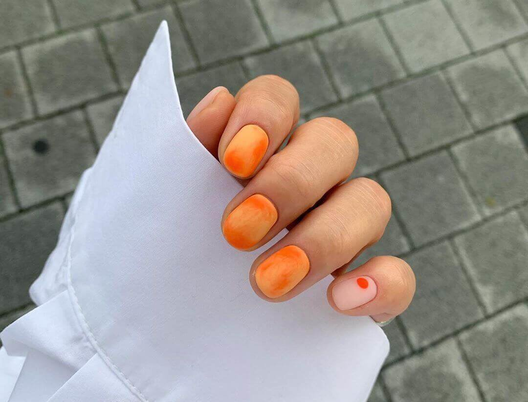 orange marbled nails