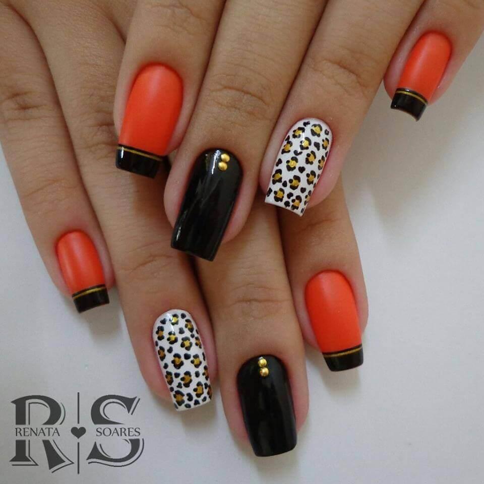 uñas naranja con negro animal print