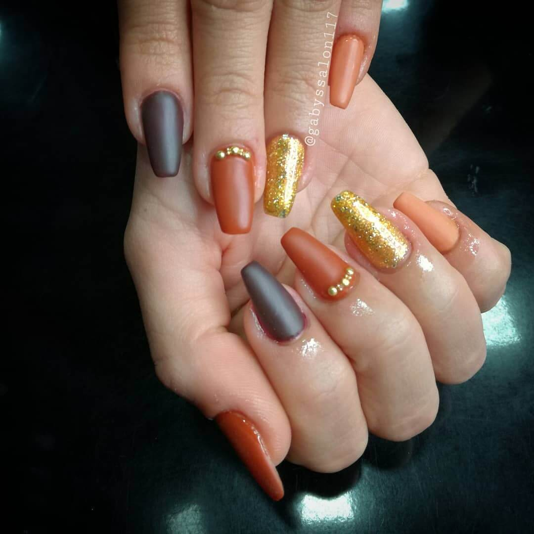 matte orange with gold nails