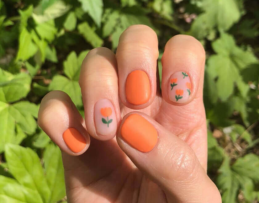matte orange nails with flowers