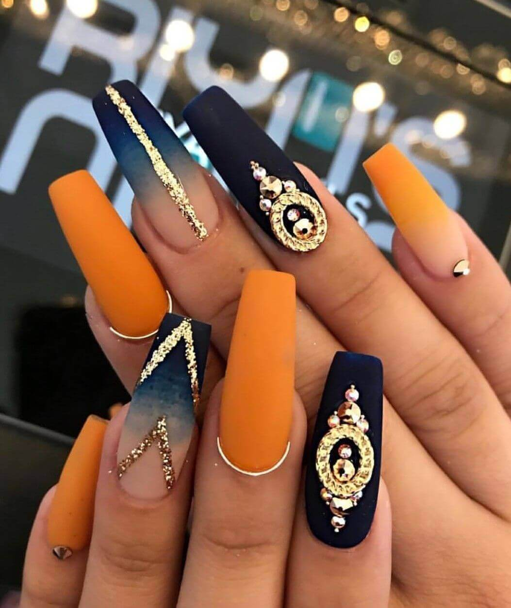 matte orange with black nails