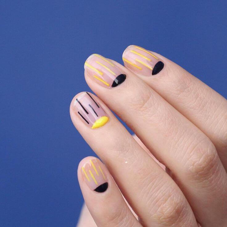 uñas sencillas amarillas y negras
