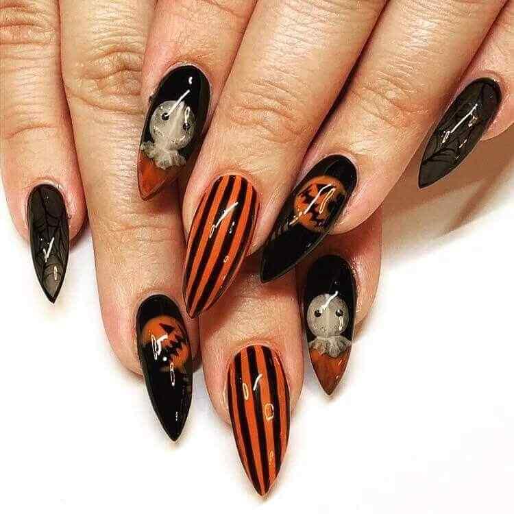 uñas de halloween naranja negras