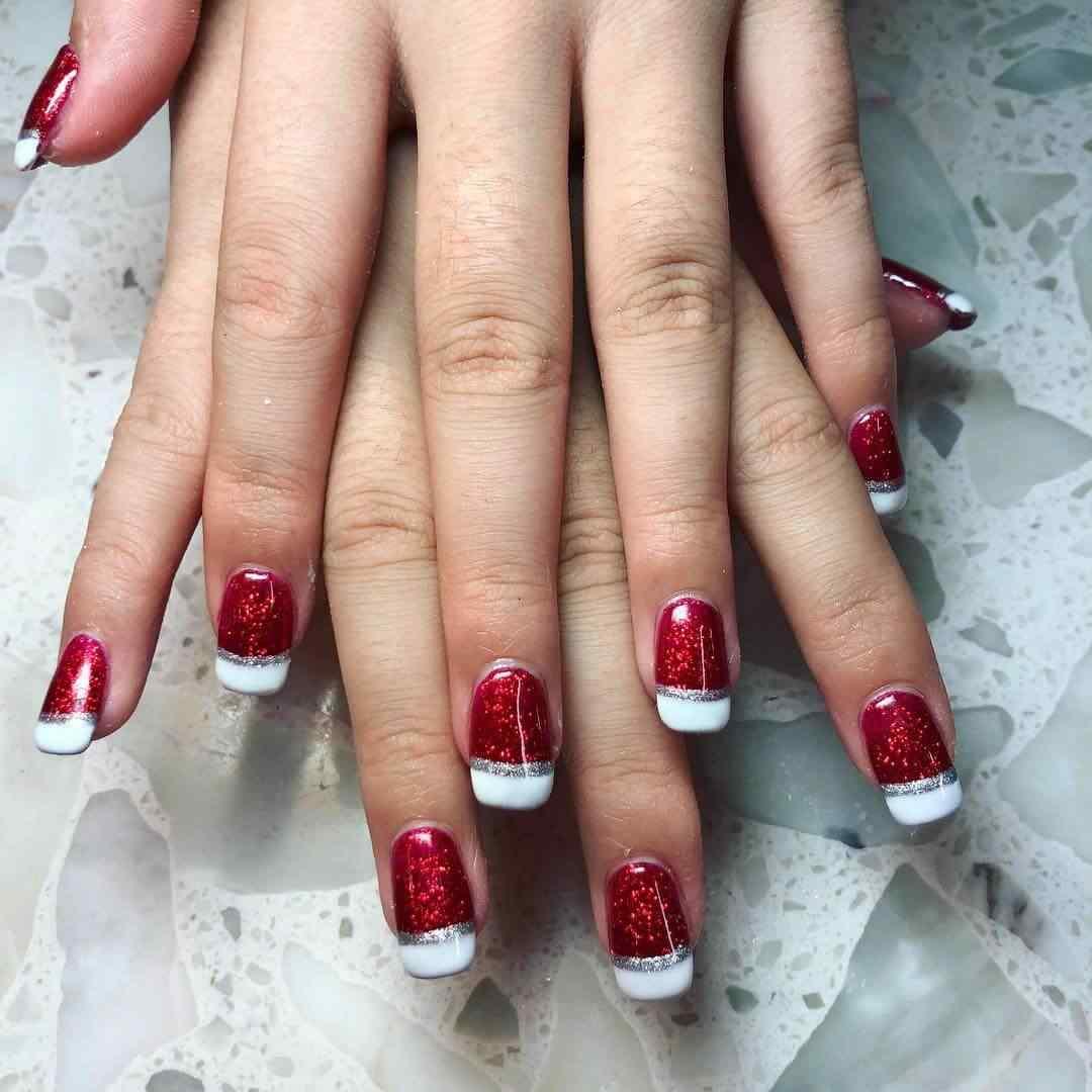 uñas francesas rojas estilo navideñas