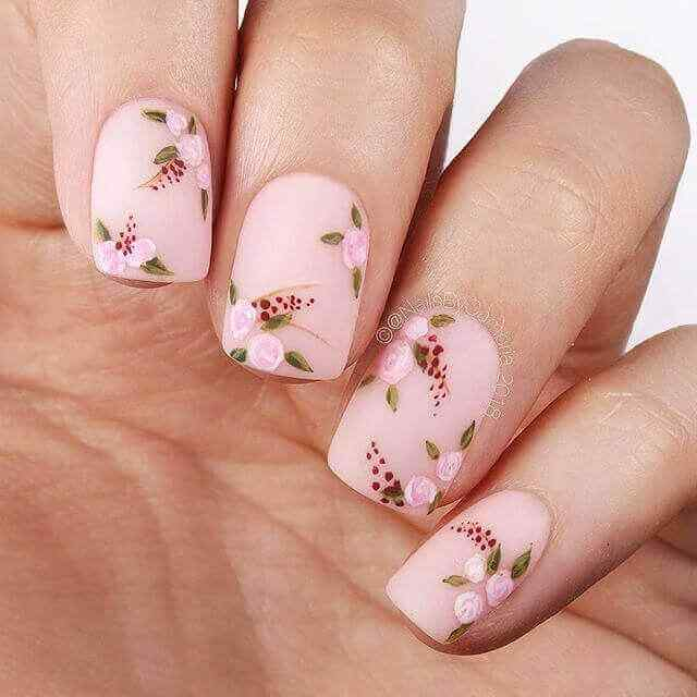 Pink nails decorated with flowers