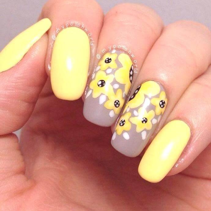uñas decoraas con flores amarillas
